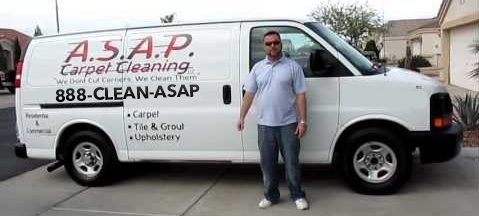 Man standing in front of an ASAP Carpet Cleaning van using 1-888-CLEAN-ASAP