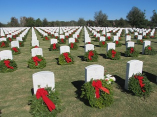 Hundres of green and red wreaths laid at veteran gravestones